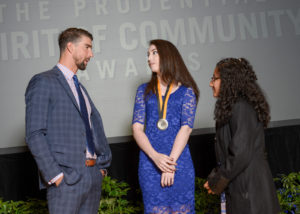Olympic gold medalist Michael Phelps congratulates Emma Albertoni, 18, of Arvada (center) and Breanna Remigio, 14, of Aurora (right) on being named Colorado's top two youth volunteers for 2017 by The Prudential Spirit of Community Awards. Emma and Breanna were honored at a ceremony on Sunday, May 7 at the Smithsonian's National Museum of Natural History, where they each received a $1,000 award. (PRNewsfoto/Prudential Insurance)